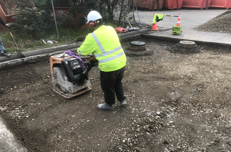 Compacting in preparation for concrete or asphalt